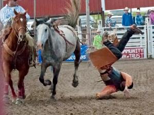 orange cowboy hits the ground
