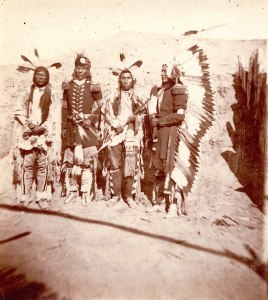Bobtailed Bull, one of Custer's favorite scouts in the Indian Wars against the Sioux is second from the left.