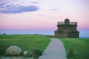 A rebuilt blockhouse above Fort Lincoln marks the uppermost reach of the Fort where General Custer and his scouts once lived.